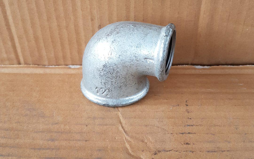 Gomito a 90° ridotto in ferro 1×1.1/2FF